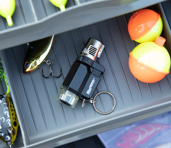 Mag-Torch MT16 Pocket Torch sitting in a fishing tackle box next to bobbers