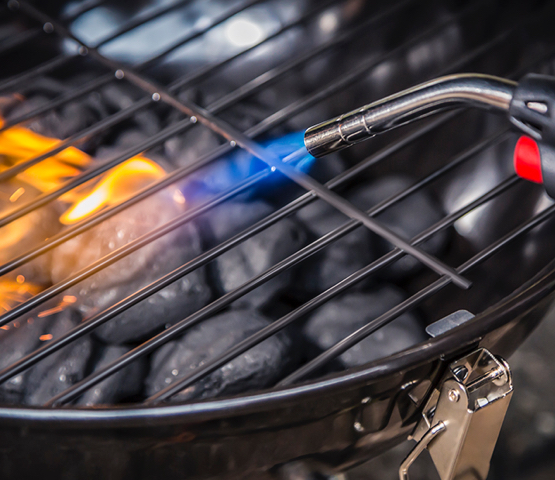 MT525C being used to light coals in a grill