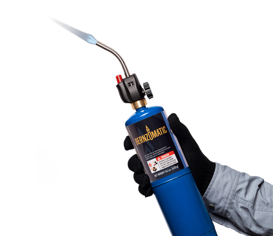 Person with black gloved holding a Mag-Torch MT525 Self-Lighting Torch connected to a Bernzomatic propane cylinder