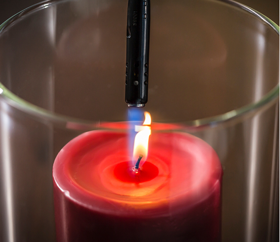 MT759 lighter lighting a red candle