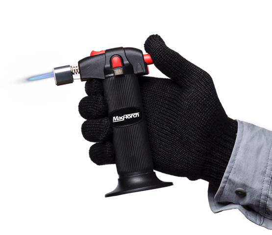 Person with black gloves holding a Mag-Torch MT780 torch